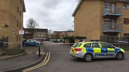 A housing estate's courtyard next to St Ann's Road, Barking, cordoned off after an 18-year-old was s