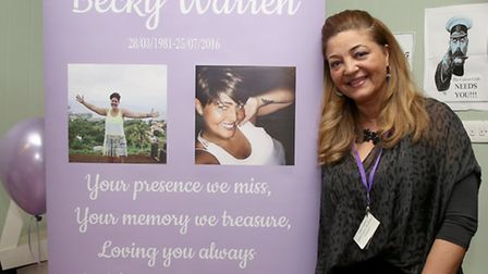 Jakki Warren with a banner dedicated to her sister, Becky Warren, who died last year, at Curzon Comm