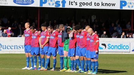 Dagenham & Redbridge players observe a minute's silence before the game with York City (pic: David S