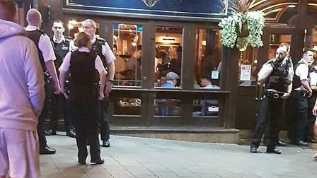 Police officers outside the pub (Picture: Jamie Andrews