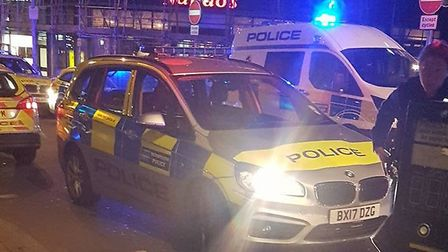 A number of police vehicles parked in Station Parade as officers dealt with the brawl (Picture: Jami