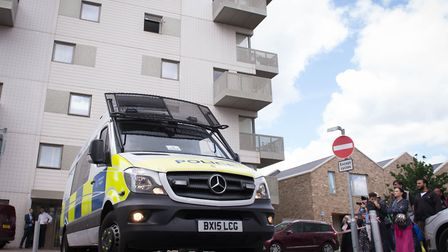 Police at the scene of a block of flats in Barking where arrests were made (Picture: Stefan Rousseau