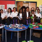 Beal Academy and Sidney Russell School pupils preparing bags of goods to pass on to victims of the G