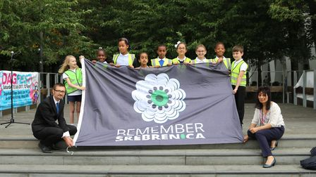 Pupils from Gascoigne Primary School hold the Srebrenica remembrance flag (Picture: LBBD)