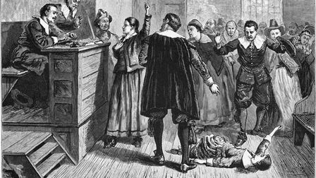 Witchcraft at Salem Village. Engraving. The central figure in this 1876 illustration of the courtroo