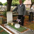 Dave Rose with the grave of a soldier who died aged 19 and whose name is not on any memorial in Bark