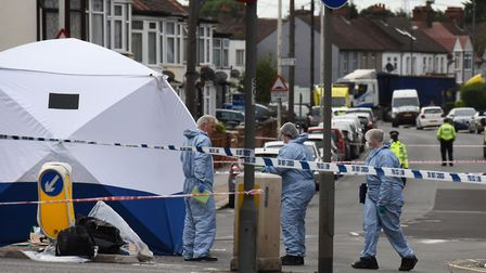 Police at the scene of a murder on the corner of Movers Lane and Ripple Road in Barking