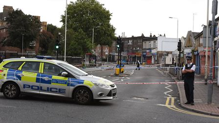 Police at the scene on Ripple Road near to the junction with Movers Lane in Barking