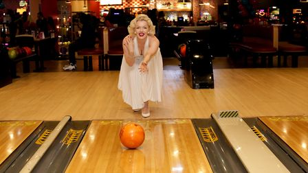 A Marilyn Monroe lookalike bowls the first ball at the refurbished alley Picture: Andrew H Williams