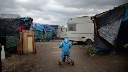Child in the former Jungle refugee camp in Calais, France. Picture: Anthony Devlin/PA Wire