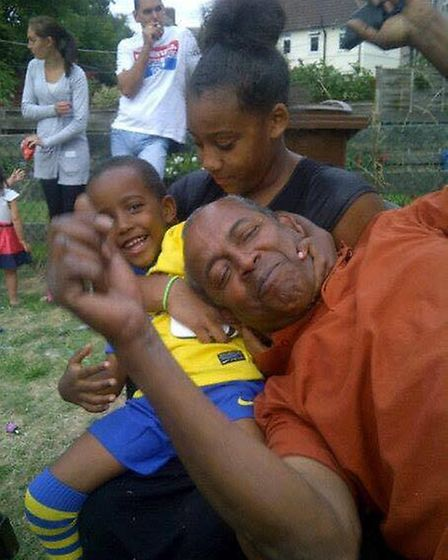 Clemuth Roberts playing with grandson Corey Roberts and grandaughter Shannon Roberts. Picture credit