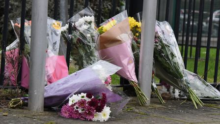 Flowers left at the scene of the stabbing near Abbey Road in Barking