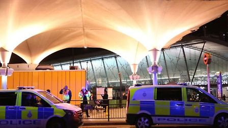 Police at the scene of the acid attack in Stratford. Picture: PA