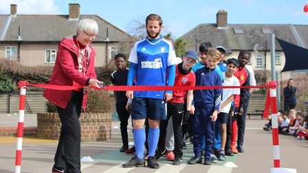 Cllr Evelyn Carpenter cuts the ribbon at the start of the sponsored walk Picture: Rachel Andreou