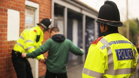 Police officers doing a stop and search. Picture: Ian Burt