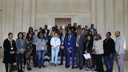 Andy Ginn, from CU London, Friday Adejo, Health and Social Care BA course leader and students celebr