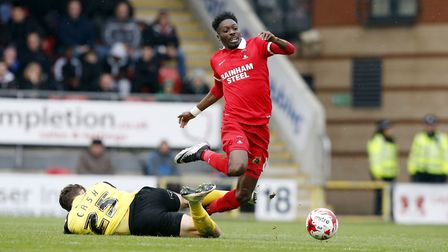 Blair Turgott, pictured during a spell at Leyton Orient, narrowly avoids goalkeeper Cashs clutches.