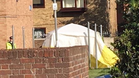 A tent is up outside of a block of flats at the scene in Crows Road, Barking after a man was stabbed
