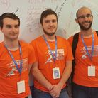 Viktor Linde, 19 (centre), came second place out of thousands of IT students from across the world.