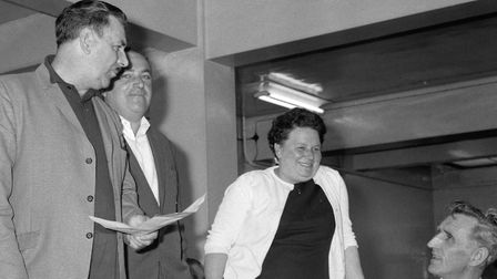 Mrs Rose Boland, shop steward for the women machinists at Ford Dagenham, smiles as she receives appl
