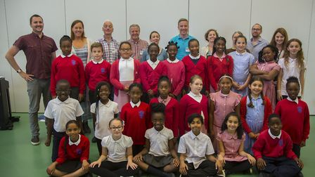 BBC Singers choir members strike a (vocal) chord with Manor Longbridge pupils. Picture: Ellie Hoskin