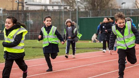 Children taking part in The Daily Mile at Mile End stadium. Picture: Carmen Valino