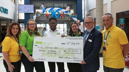 Asda staff donating �25,000 to Queen's Hospital Picture: Doug Blanks