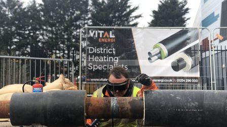 Operators from Vitali Energi installing piping, which will connect the old Civic Centre, Becontree L