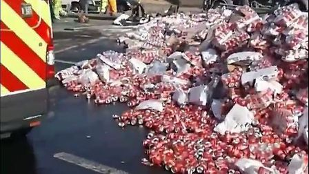 Hundreds of Coca-Cola cans were left in the road following the crash