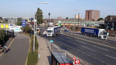 The A13 is closed after a lorry crashed into the central reservation.