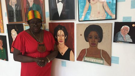 Curator of the exhibition, Desiree Ntolo, beside her self-portrait. Picture: Rhiannon Long