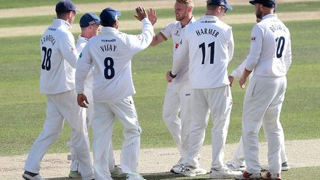 Jamie Porter of Essex celebrates with team mates after taking the wicket of Daryl Mitchell (pic Gavi