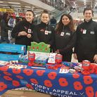 Public services students from Barking and Dagenham College helped with the poppy appeal in Tesco. Pi