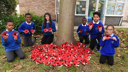 Pupils from Gascoigne Primary School with the poppies produced for their Remembrance project.