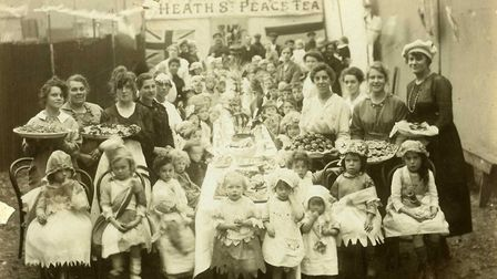 Women and children celebrating the end of the First World War at the Heath Street Peace Tea Party, c