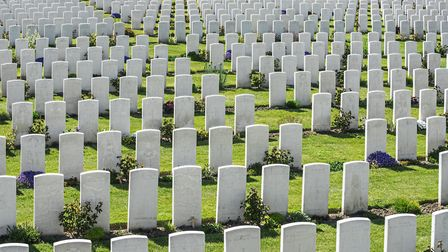 White headstones at the Tyne Cot Cemetery, Commonwealth War Graves Commission burial ground for Firs