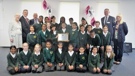 Pupils from Warren Junior School, which has just opened a teacher training centre, with leader of th
