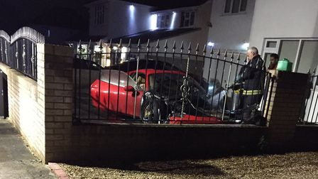 Jurors were shown this photo of the burned out Ferrari in the drive of a home on Nelmes Crescent, Em