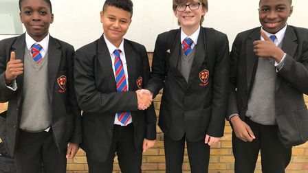 Lifesaver Ryan (centre left) shakes hands with classmate Harry, with friends Dressman and Prince. Pi