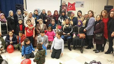 Members of the Turkish community attend the opening of the Hasan Ozcan Weekend School in Barking. Pi