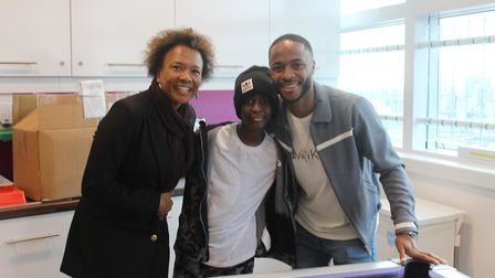Raheem Sterling with Damary Dawkins and Beverley De-Gale from the ACLT. Picture: ACLT
