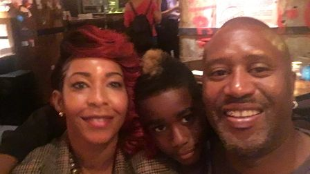 Damary Dawkins with his parents Nadine and Tony. Picture: ACLT