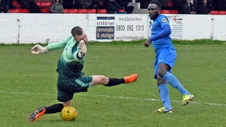 Kemo Darboe is denied by Harry Palmer (pic Terry Gilbert)