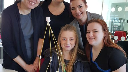 The marshmallow challenge tests students' teamwork (Lucy Blythe is pictured front centre). Picture:
