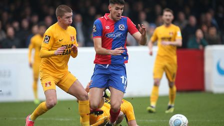 Conor Wilkinson of Dagenham with pressure from Orient's Sam Ling (Pic: Gavin Ellis/TGS Photo)