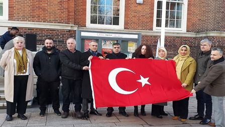 A memorial ceremony for Hasan Ozcan saw the Turkish flag raised outside Barking Town Hall. Picture: