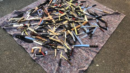 Knives collected from one 'surrender bin'. Picture: WORD 4 WEAPONS