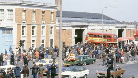 Dozens of people gathered in 1979 to see the buses into retirement. Picture: David E Jones.