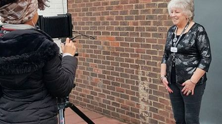 Brenda, a barmaid at The Beacon Tree pub, being photographed for the exhibition. Picture: The Collec