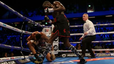 Lawrence Okolie (right) knocks down Wadi Camacho during their British and Commonwealth Championship